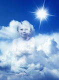 Dreaming child on a sunny sky Stock Images