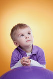 Dreaming cute little boy looking up Royalty Free Stock Image