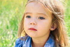 Dreaming cute little girl on the meadow Royalty Free Stock Images