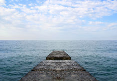 Dreaming on a empty concrete pier Royalty Free Stock Image
