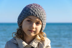 Dreaming expression child portrait wool cap Stock Photography