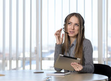 Dreaming female customer support officer Royalty Free Stock Image