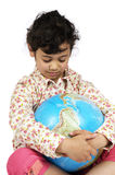 Dreaming Of The Future. Stop the global warming! Picture of a girl holding a globe, she's dreaming of a better future Stock Photos