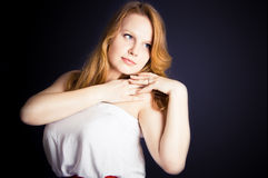 Dreaming ginger young woman Stock Photo