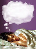 Dreaming Girl. Young girl sleeping in her bed, with a dreaming fluffy balloon above her head Stock Photos