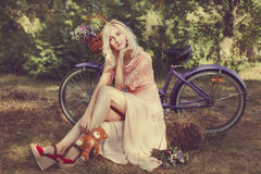 Dreaming girl with a bicycle. Stock Image