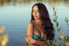 Dreaming girl in bikini Stock Image