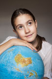Dreaming girl with blue globe. Portrait Royalty Free Stock Image