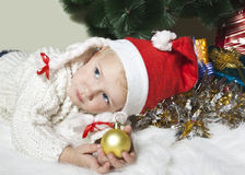 Dreaming girl with Christmas ball Stock Photos