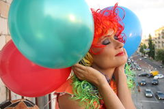 Dreaming Girl in colorful wig with balloons Royalty Free Stock Photo