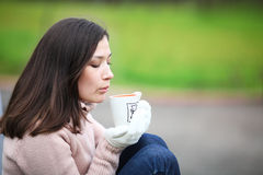 Dreaming girl with cup of coffee Stock Photo
