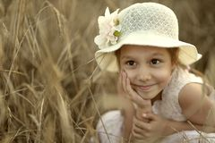 Dreaming girl in fied Royalty Free Stock Images