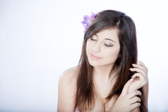Dreaming girl with flower in hair Stock Photo