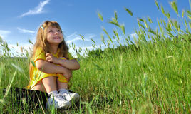 Dreaming girl in the grass Stock Photography