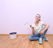 Dreaming girl in house renovation, lilac color Stock Photography
