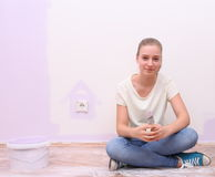 Dreaming girl in house renovation, lilac color Royalty Free Stock Image