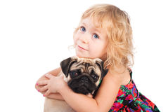 Dreaming girl hugging dog isolated on white Royalty Free Stock Image