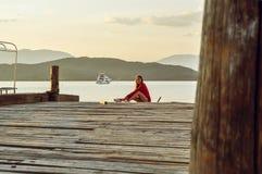 Dreaming girl on lake Stock Photo