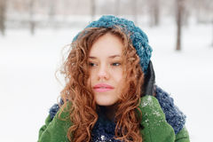 Dreaming girl looks away outdoor at winter day Stock Photography