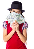 Dreaming girl with money in hands. Dreaming girl in black hat hide face in money in hands, isolated on white Stock Photos
