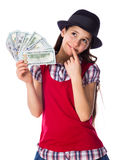Dreaming girl with money in hands. Dreaming girl in black hat with money in hands, isolated on white Stock Photos