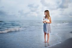 Dreaming girl and the ocean royalty free stock image