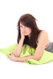Dreaming girl in pajamas lying with green pillow Royalty Free Stock Photography