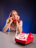 Dreaming girl with red telephone. Royalty Free Stock Photos