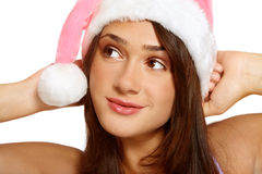 Dreaming girl in Santa hat Stock Photos