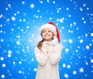 Dreaming girl in santa helper hat Royalty Free Stock Images