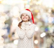 Dreaming girl in santa helper hat Royalty Free Stock Photos
