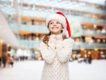 Dreaming girl in santa helper hat Royalty Free Stock Image
