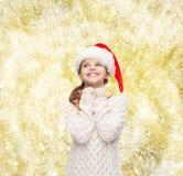 Dreaming girl in santa helper hat Stock Photo
