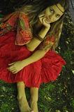 Dreaming Girl Sitting On The Grass In The Park Royalty Free Stock Image