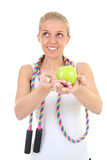 Dreaming girl with skipping rope and apple Royalty Free Stock Images