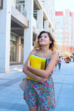 Dreaming girl, student with books Royalty Free Stock Image