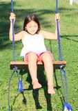 Dreaming girl on swing Stock Image