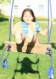 Dreaming girl on swing Royalty Free Stock Image