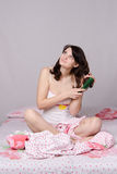 Dreaming girl waking up brushing her hair Royalty Free Stock Image