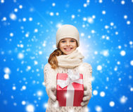 Dreaming girl in winter clothes with gift box Stock Photography