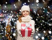 Dreaming girl in winter clothes with gift box Stock Photo