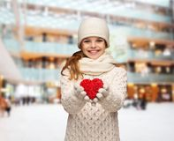 Dreaming girl in winter clothes with red heart Royalty Free Stock Photography
