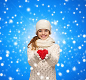 Dreaming girl in winter clothes with red heart Royalty Free Stock Image