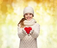 Dreaming girl in winter clothes with red heart Stock Photography
