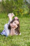 Dreaming  girls rest  on the grass Royalty Free Stock Photo