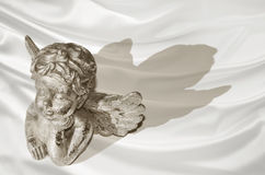 Dreaming golden guardian angel on a background Royalty Free Stock Photo