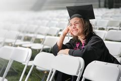 Dreaming graduate. Happy graduate daydreaming. Closeup, shallow DOF royalty free stock photography