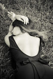 Dreaming in grass woman portrait in bw Royalty Free Stock Photography