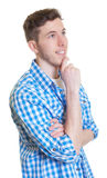 Dreaming guy in a checked shirt Stock Photography