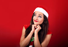 Dreaming happy woman in santa claus christmas costume looking up Royalty Free Stock Photo
